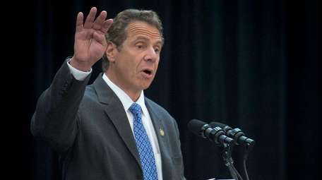 Gov. Andrew Cuomo talks to a group of