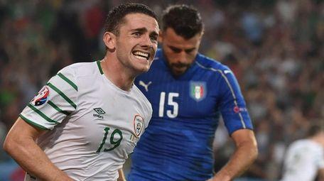 Ireland's midfielder Robert Brady celebrates scoring a goal