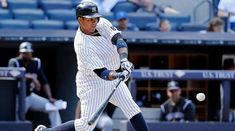 New York Yankees' Starlin Castro connects for a
