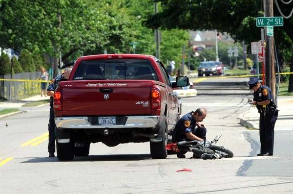 Police investigate the scene of an accident in