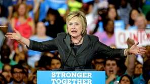 Democratic presidential candidate Hillary Clinton gestures as she