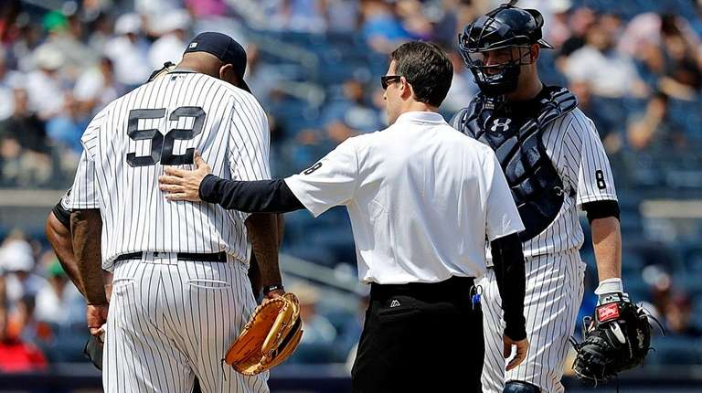 The Yankees' trainer comes to the mound to
