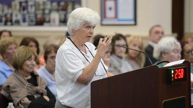Glen Cove resident Maureen Tracy speaks against the