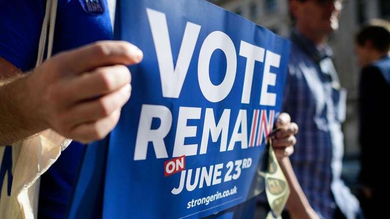 Campaigners from the 'Vote Remain' group hand out
