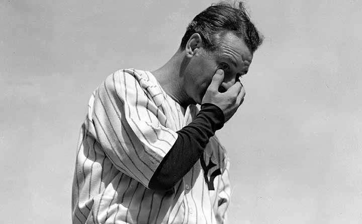 Lou Gehrig wipes away a tear while speaking