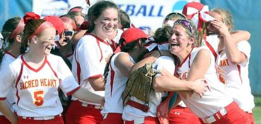 Sacred Heart celebrates winning the CHSAA league softball