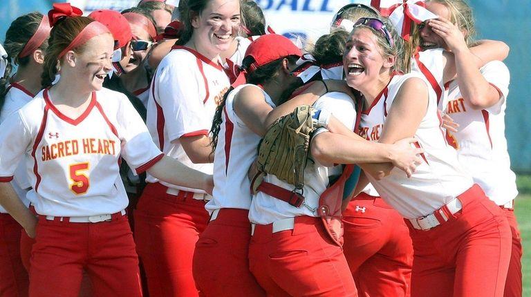 Sacred Heart celebrates winning the CHSAA league softball