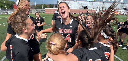 Mount Sinai players revel in jubilation following the