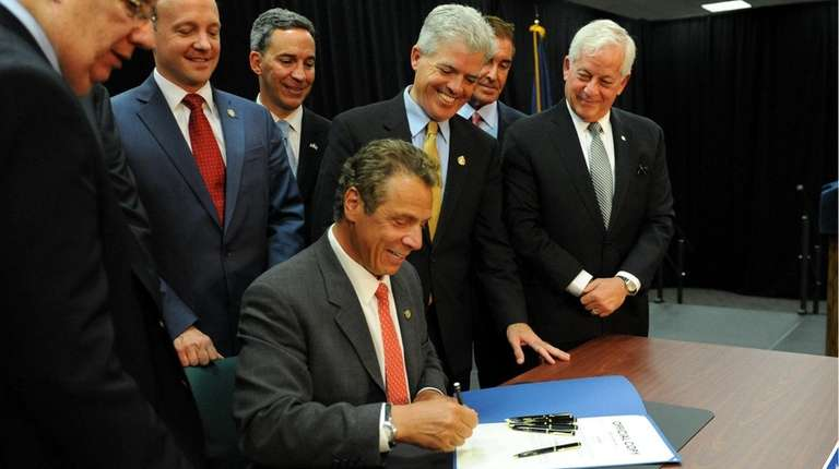New York governor Andrew Cuomo, signs the zombie