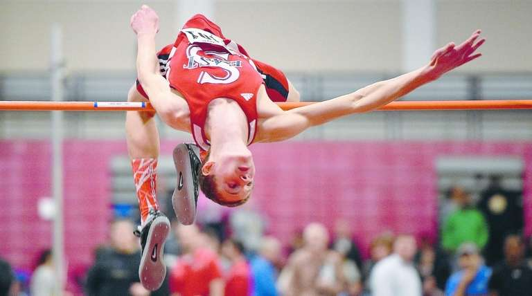 Smithtown East's Daniel Claxton clears 6-10 in the