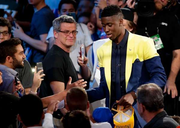 Caris LeVert is congratulated by basketball fans after