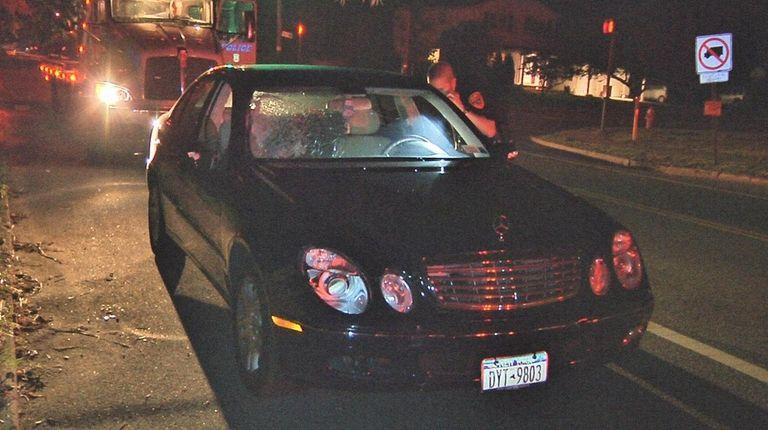 A motorist in a Mercedes-Benz struck four pedestrians,