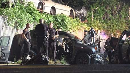 Police investigate the scene of a two-vehicle crash
