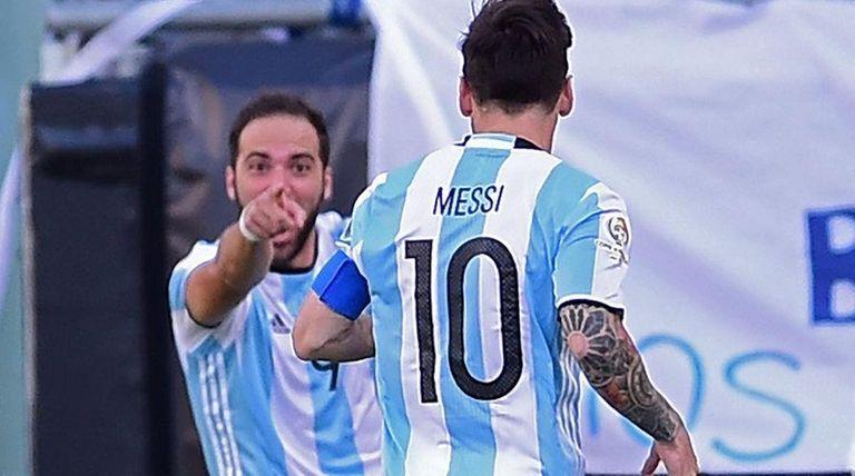Argentina's Gonzalo Higuain, left, celebrates with teammate Lionel
