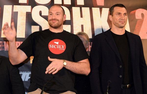 British heavyweight boxer Tyson Fury, left, poses alongside