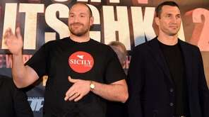 British heavyweight boxer Tyson Fury, left, poses alongside