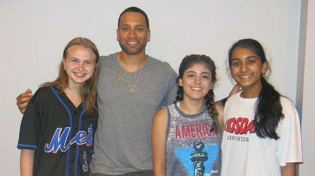 Mets first baseman James Loney poses with Kidsday