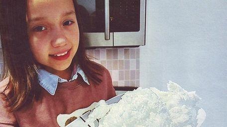 Kidsday reporter Kiara Anderson with her homemade snow.