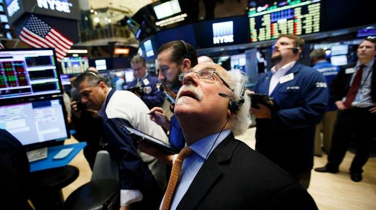 Traders watch the boards Friday, June 24, 2016,