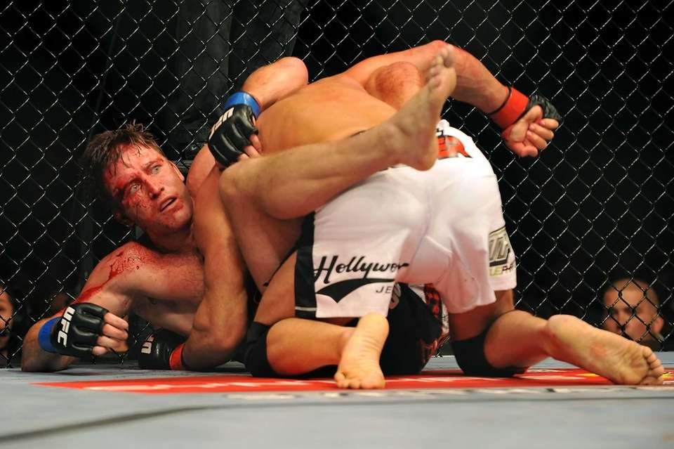 Stephan Bonnar is held by Mark Coleman during