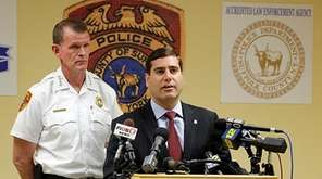 Suffolk County Police Chief Stuart Cameron, left, and