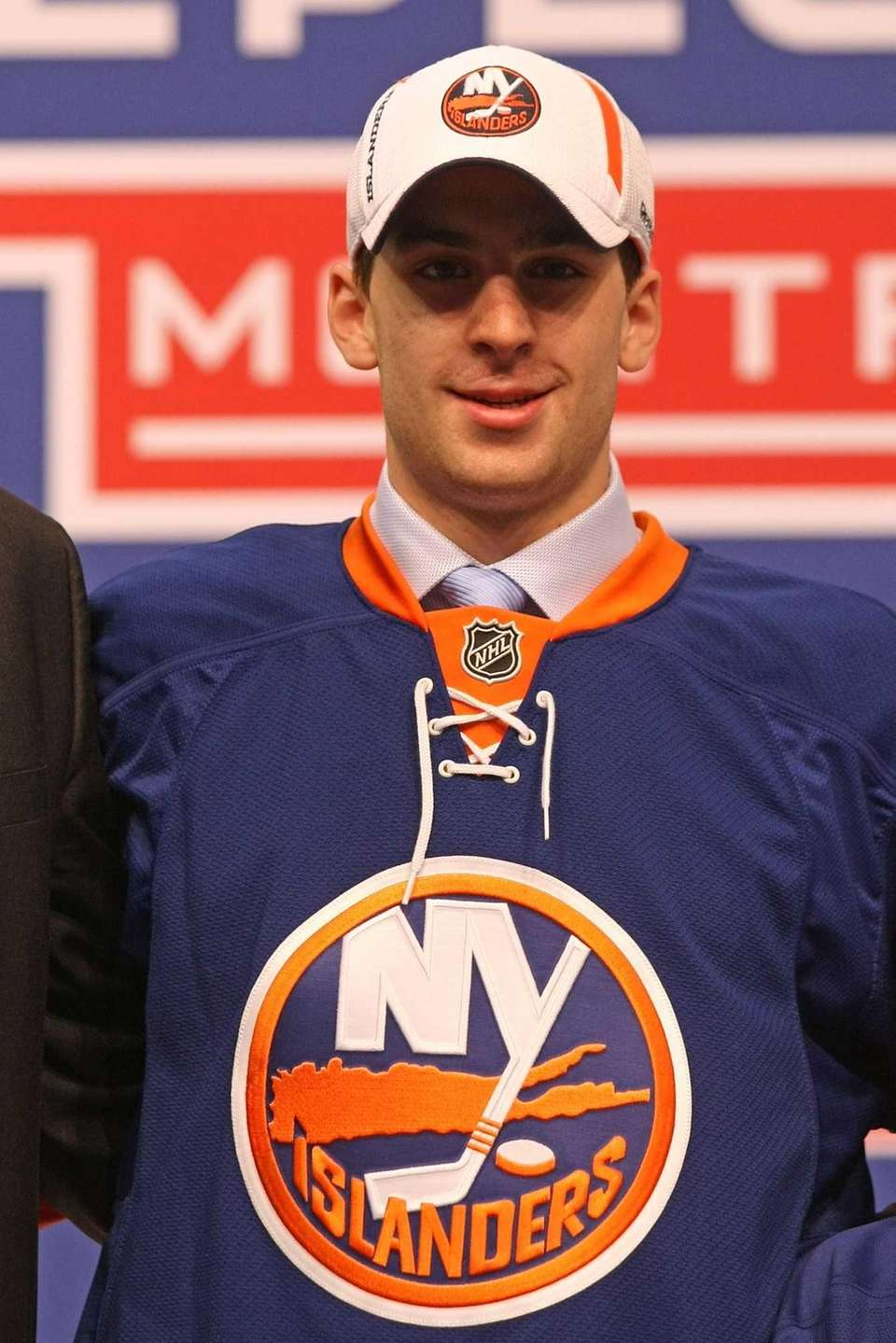 John Tavares stands on stage after being picked