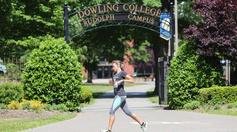 A woman runs by the entrance to Dowling