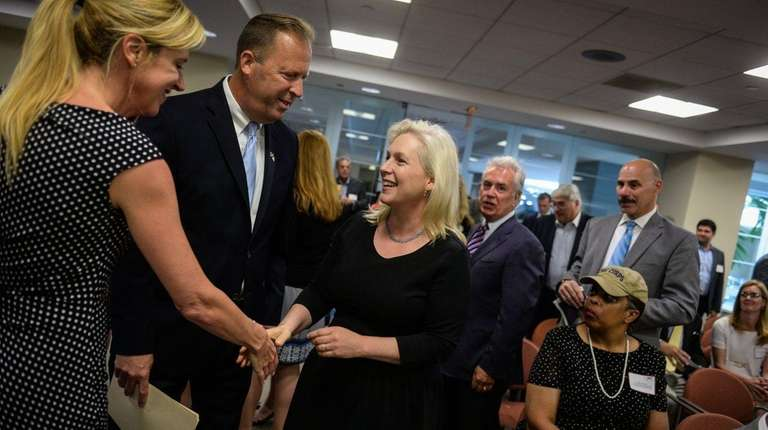 Sen. Kirsten Gillibrand greets people before addressing the