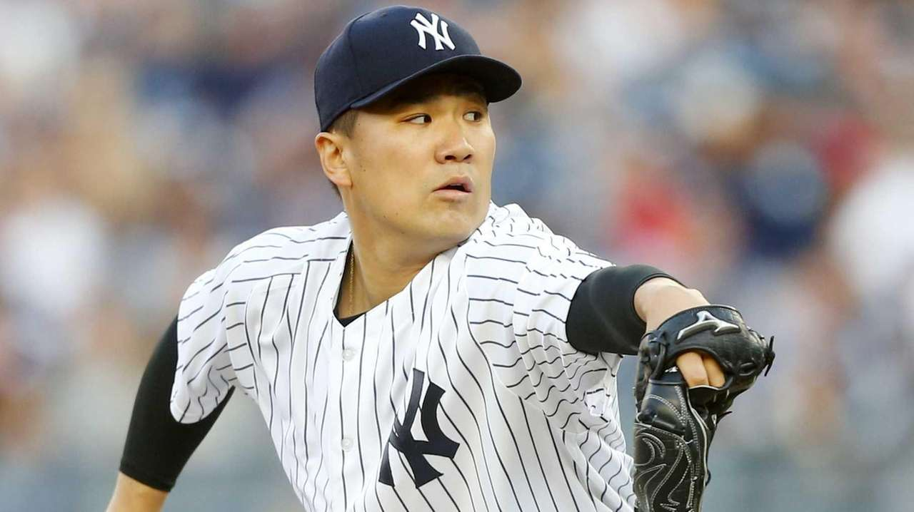 Masahiro Tanaka of the Yankees pitches in the