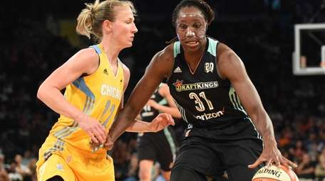 New York Liberty center Tina Charles is defended