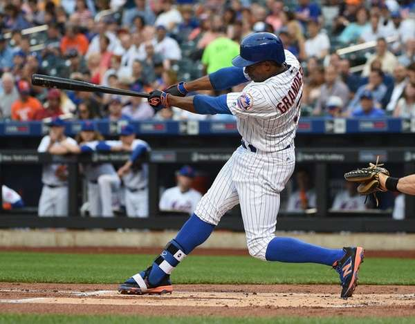New York Mets rightfielder Curtis Granderson follows through