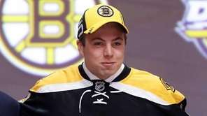 Charlie McAvoy celebrates with the Boston Bruins after