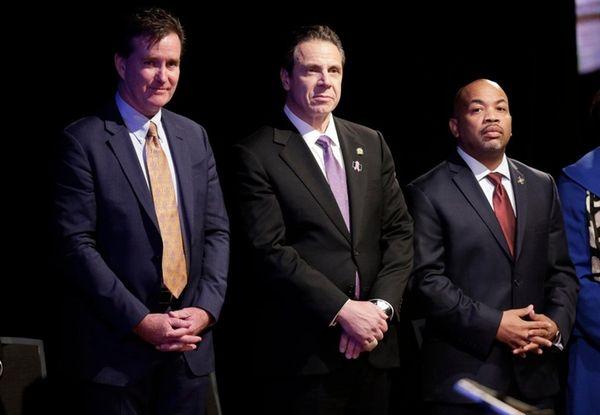 Gov. Andrew Cuomo, center, is pictured with Senate