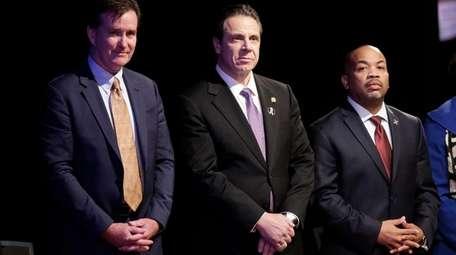 Gov. Andrew Cuomo, center, is pictured with Senate