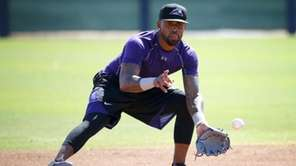 Colorado Rockies' Jose Reyes runs drills on May