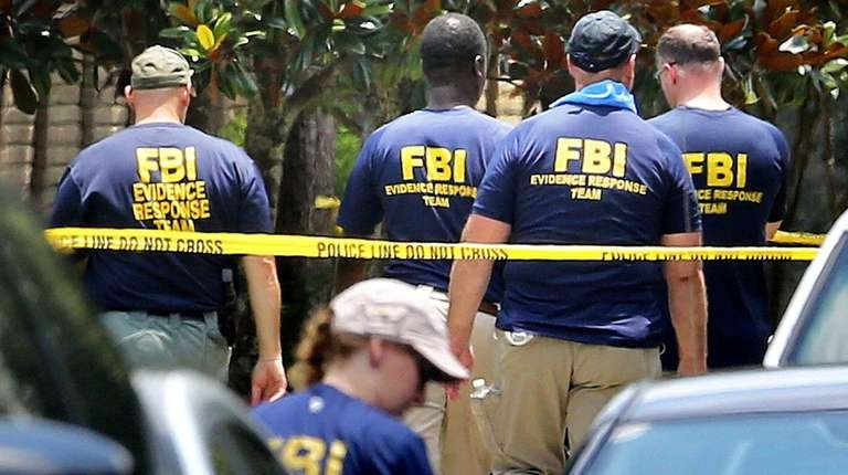 FBI agents return to the scene of the