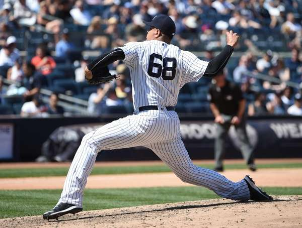 New York Yankees relief pitcher Dellin Betances delivers