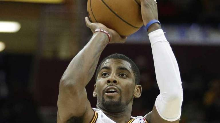 Cleveland Cavaliers' Kyrie Irving shoots a 3-point shot