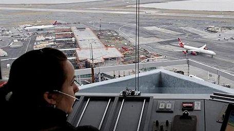 An air traffic controller at Kennedy Airport, Jan.