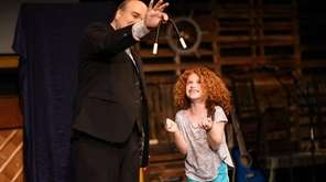 Comedy magician Pat Darienzo performs onstage with Daliah