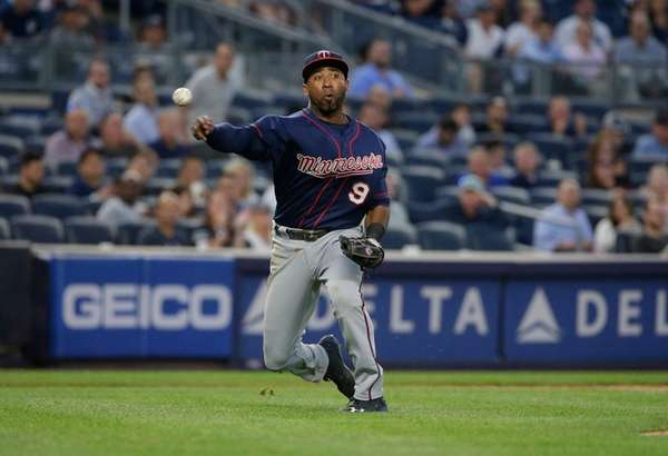 Minnesota Twins shortstop Eduardo Nunez throws to first