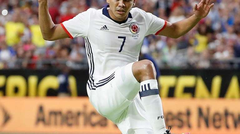 Carlos Bacca of Colombia leaps over Team