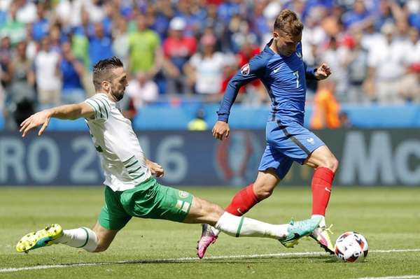 France's Antoine Griezmann, right, is tackled by Ireland's