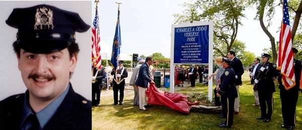 A new park sign is unveiled during a