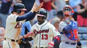 The Braves' Adonis Garcia is greeted at home