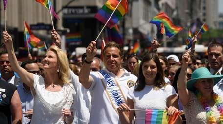 New York State Gov. Andrew Cuomo, second from