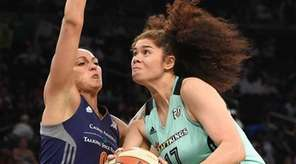 New York Liberty center Amanda Zahui B. drives