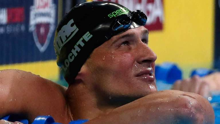 Ryan Lochte of the United States looks on