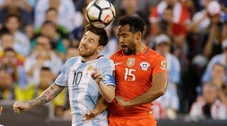 Argentina's Lionel Messi (10) heads the ball against