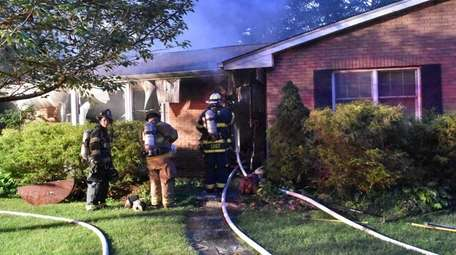 Volunteers from five departments battled a fire Monday,